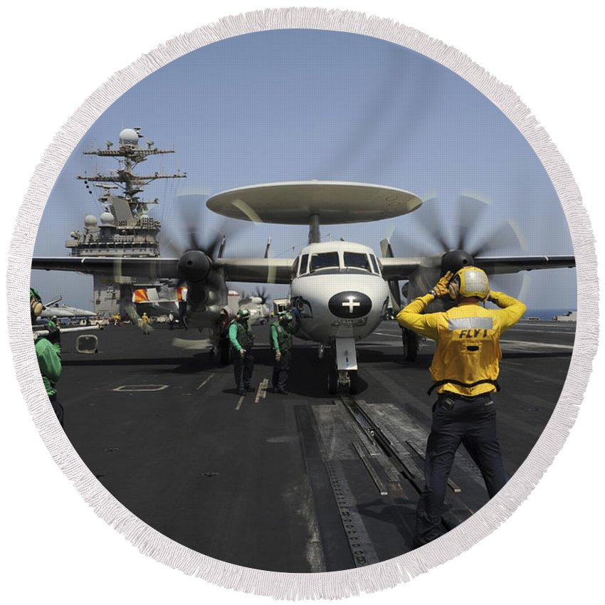 Uss Harry S Truman Round Beach Towel featuring the photograph A Plane Director Guides An E-2c Hawkeye by Stocktrek Images