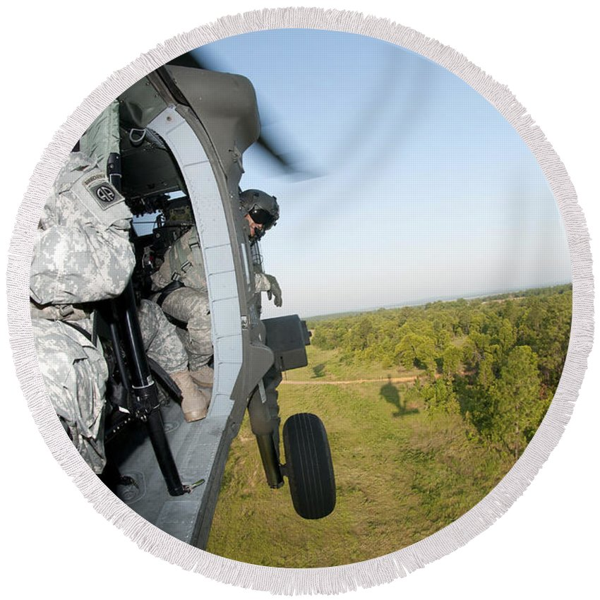 Air Assault Round Beach Towel featuring the photograph A Platoon Sergeant Prepares To Land by Stocktrek Images