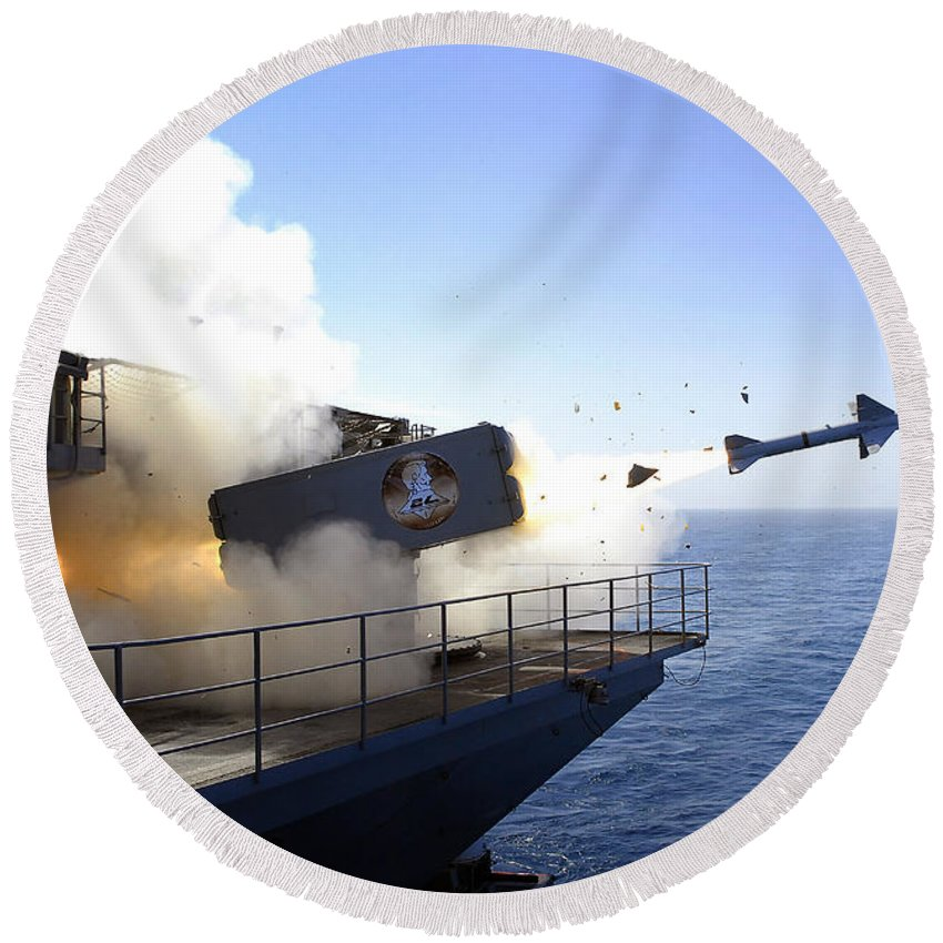 Uss Abraham Lincoln Round Beach Towel featuring the photograph A Rim-7 Sea Sparrow Missile Launches by Stocktrek Images