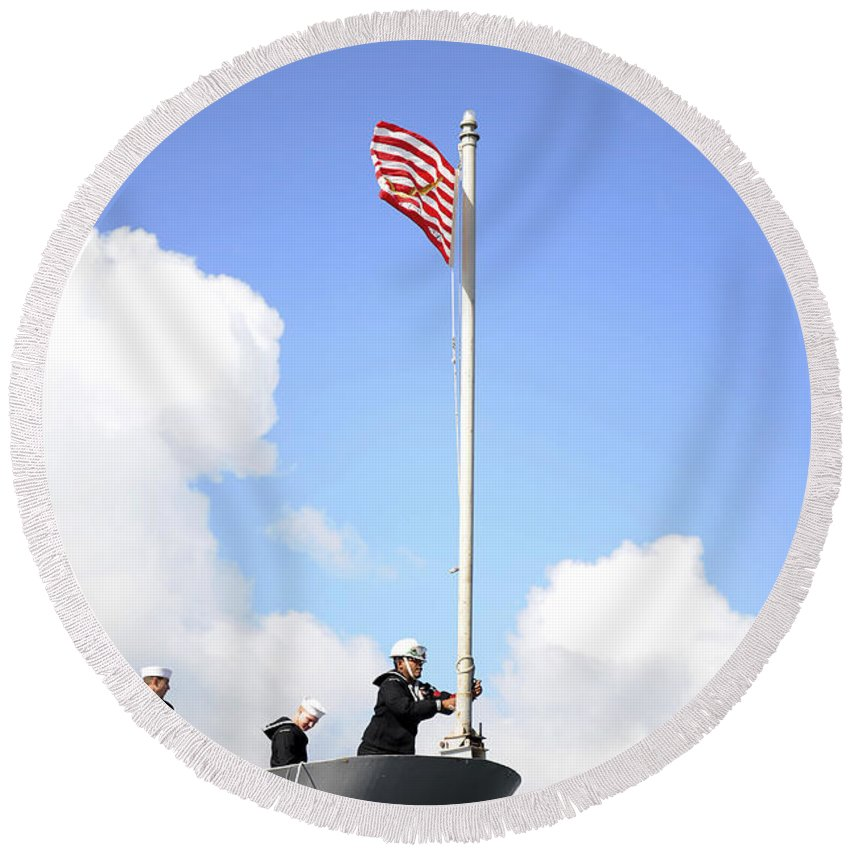 Uss Monterey Round Beach Towel featuring the photograph A Sailor Raises The First Navy Jack by Stocktrek Images