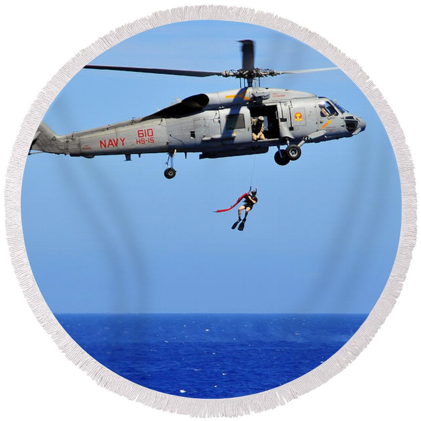 Southern Seas 2010 Round Beach Towel featuring the photograph A Search And Rescue Swimmer Is Lowered by Stocktrek Images