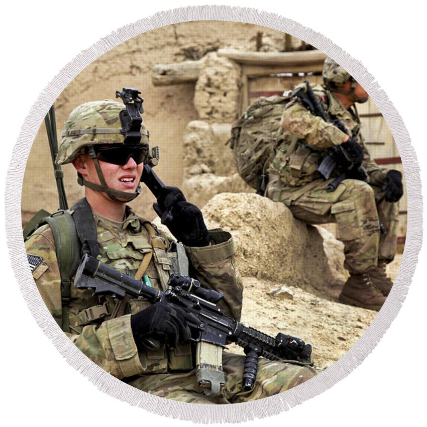 Afghanistan National Police Round Beach Towel featuring the photograph A Soldier Calls In Description by Stocktrek Images