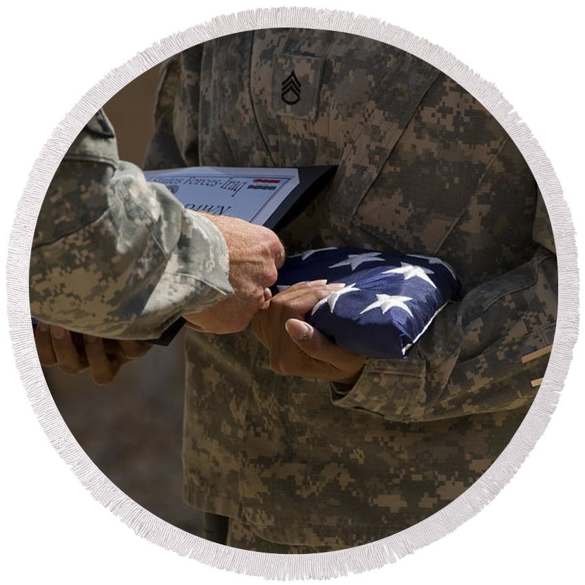 Airmen Round Beach Towel featuring the photograph A Soldier Is Presented The American by Stocktrek Images