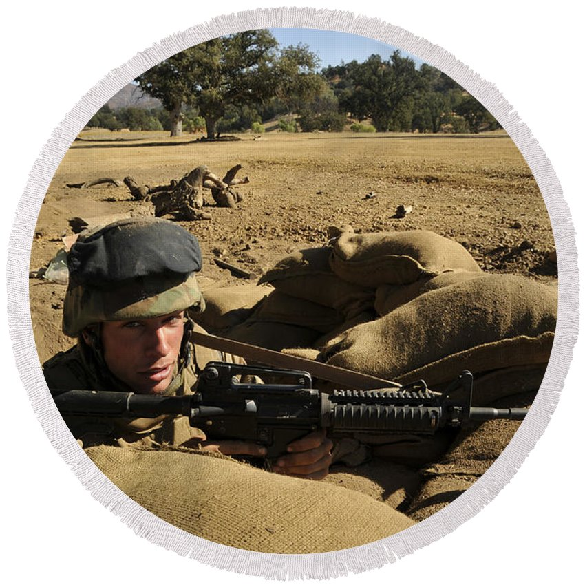 Naval Mobile Construction Battalion Round Beach Towel featuring the photograph A Soldier Mans His Position At Fort by Stocktrek Images