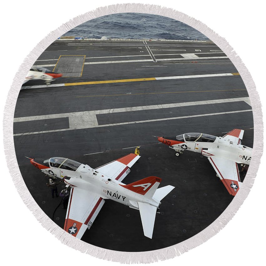 Military Round Beach Towel featuring the photograph A T-45a Goshawk Makes An Arrested by Stocktrek Images