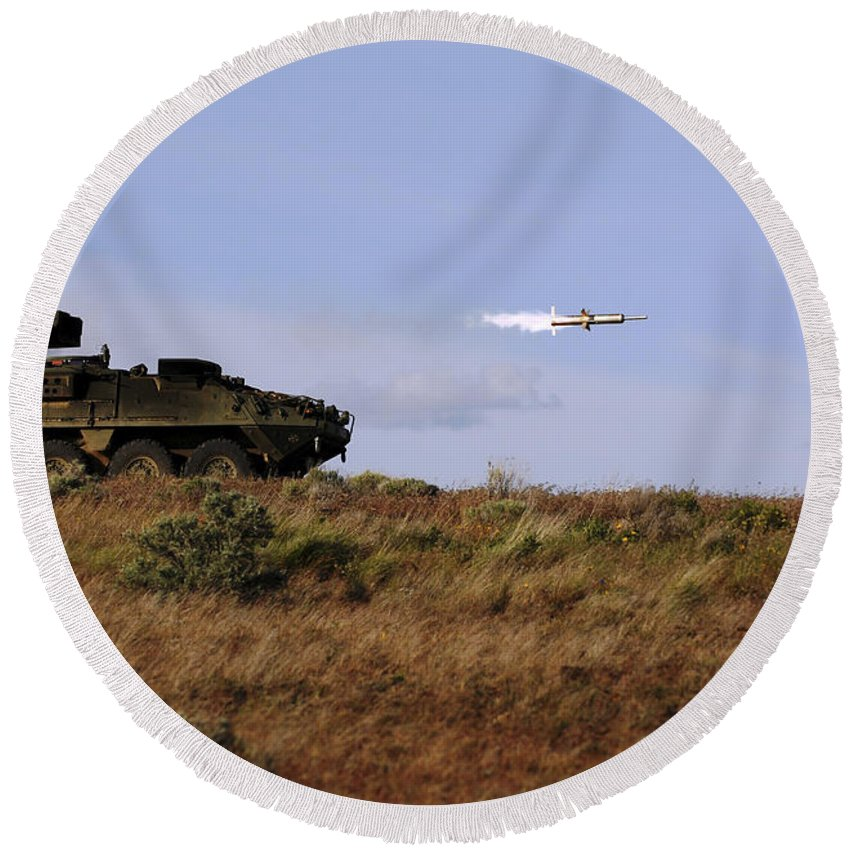 Yakima Training Center Round Beach Towel featuring the photograph A Tow Missile Is Launched From An by Stocktrek Images