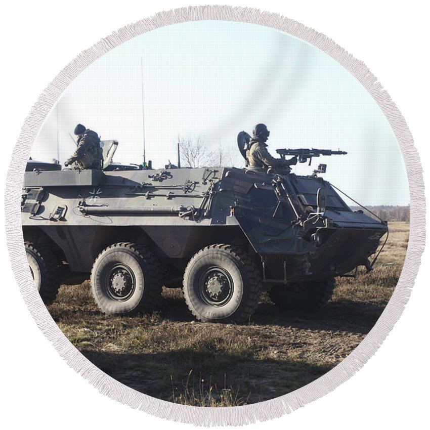 Germany Round Beach Towel featuring the photograph A Tpz Fuchs Armored Personnel Carrier by Timm Ziegenthaler