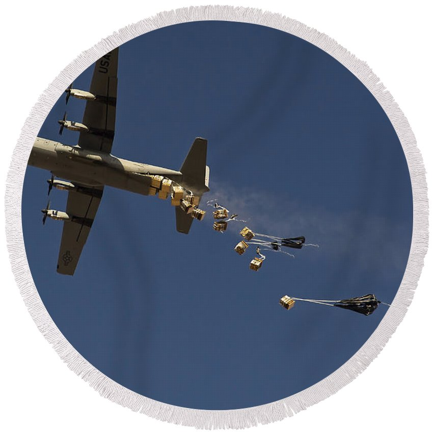 Large Group Of Objects Round Beach Towel featuring the photograph A U. S. Air Force C-130 Hercules by Stocktrek Images