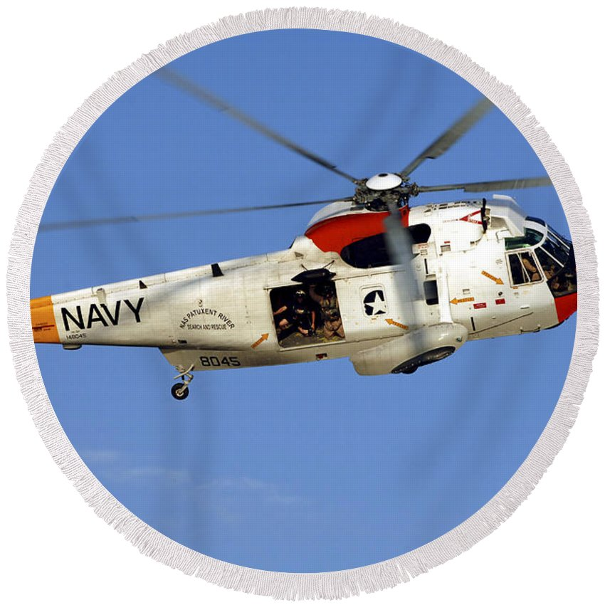 Aircraft Round Beach Towel featuring the photograph A Uh-3h Sea King Helicopter Flies by Stocktrek Images