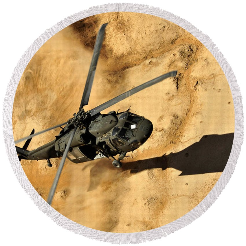Operation Enduring Freedom Round Beach Towel featuring the photograph A Uh-60 Black Hawk Helicopter Comes by Stocktrek Images