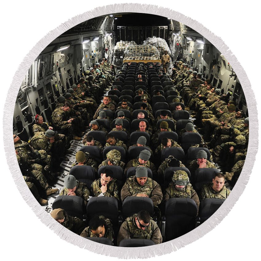 Kyrgyzstan Round Beach Towel featuring the photograph A Unit Of U.s. Army Soldiers In A C-17 by Stocktrek Images