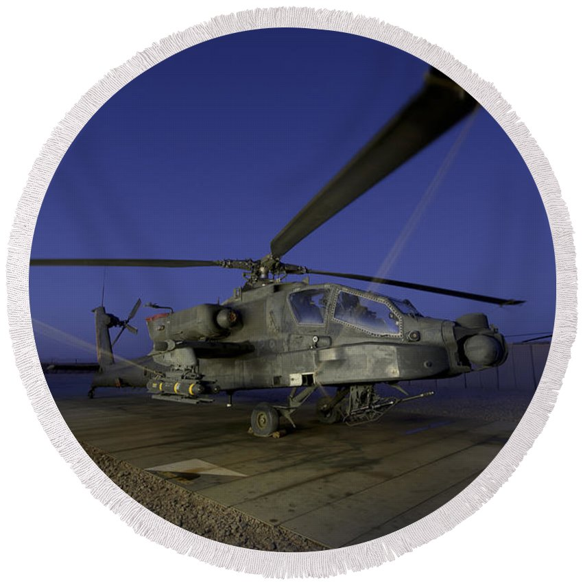 Army Round Beach Towel featuring the photograph A U.s. Army Ah-64d Apache Helicopter by Stocktrek Images