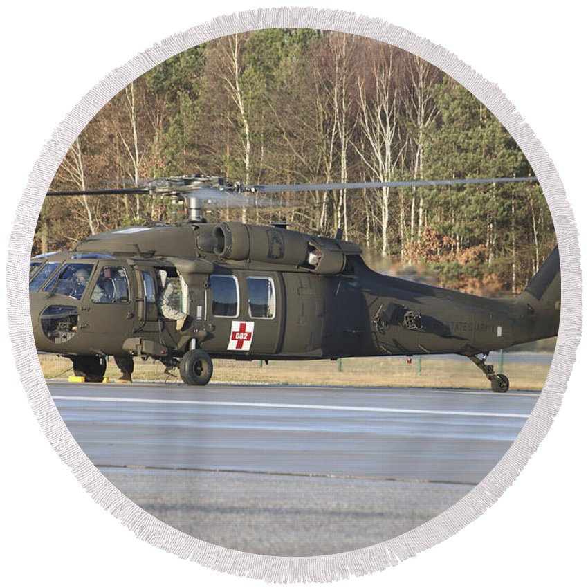 Germany Round Beach Towel featuring the photograph A U.s. Army Uh-60l Blackhawk by Timm Ziegenthaler
