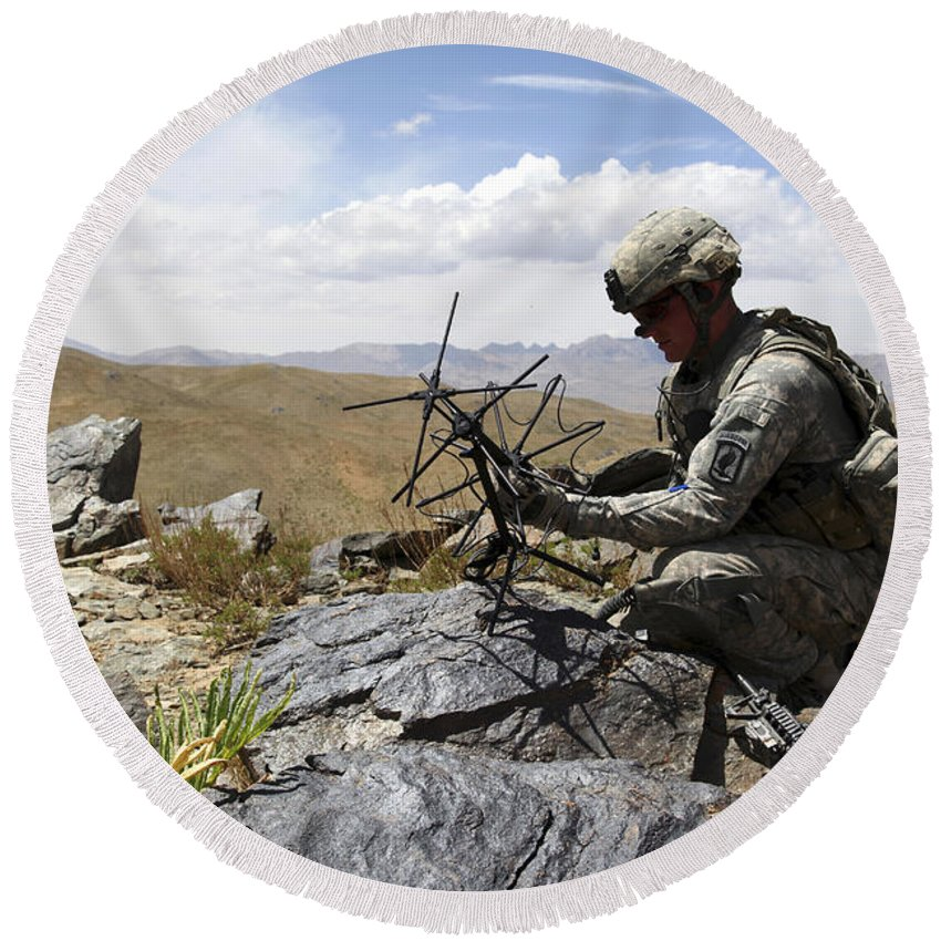 Afghanistan Round Beach Towel featuring the photograph A U.s. Soldier Sets Up A Portable by Stocktrek Images