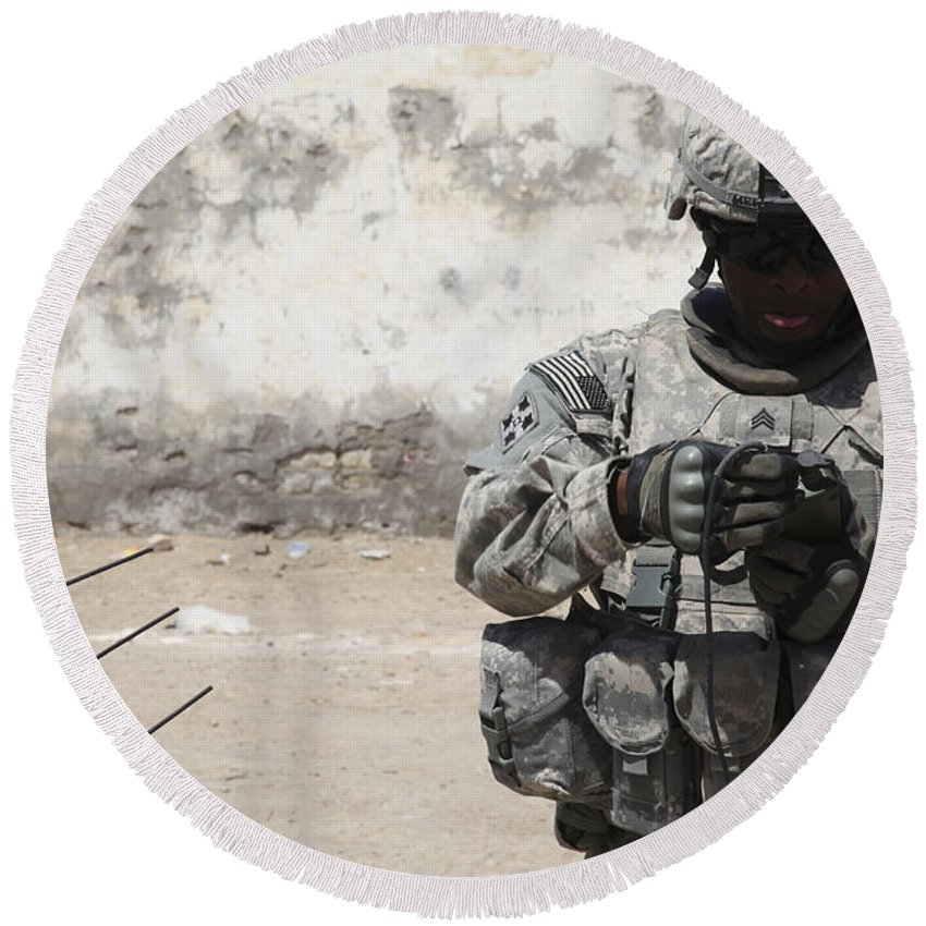 Patrol Round Beach Towel featuring the photograph A U.s. Soldier Tests A Tactical by Stocktrek Images