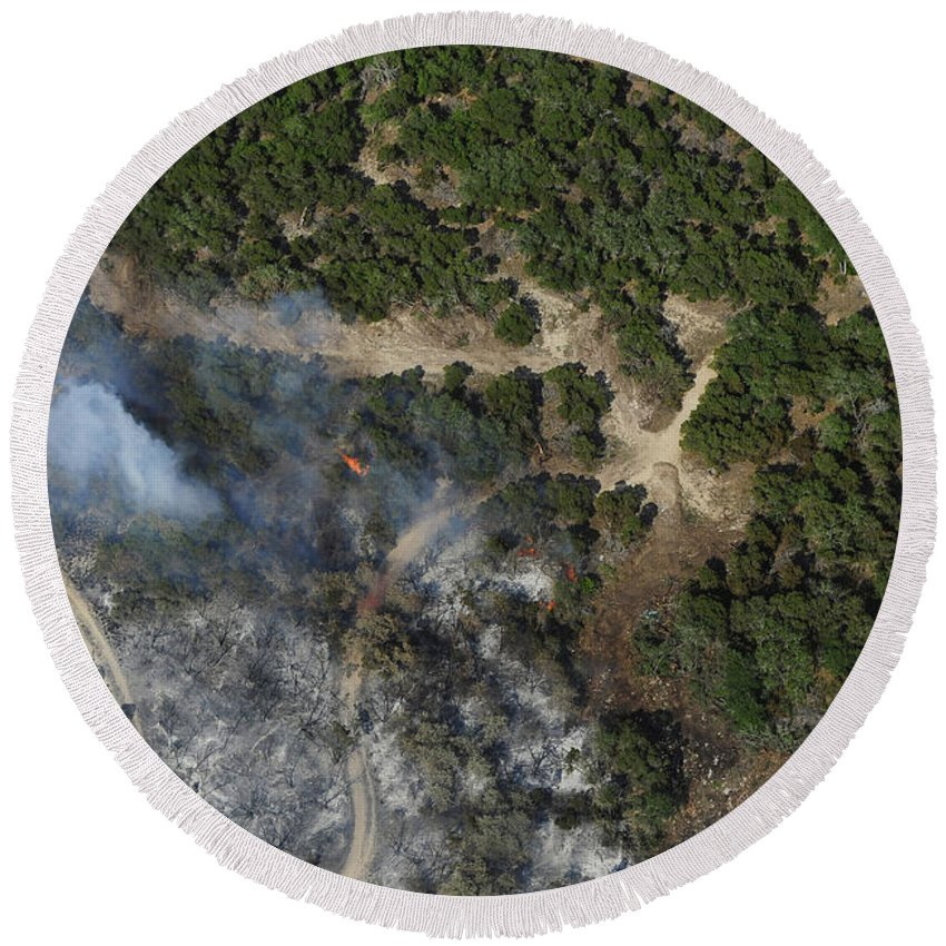 Wildfire Round Beach Towel featuring the photograph A Wildfire Burns Land Near Austin by Stocktrek Images