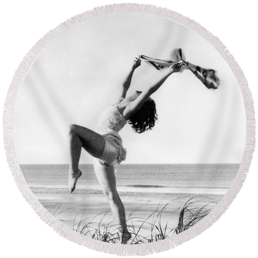 16-20 Years Round Beach Towel featuring the photograph A Woman Dancing On The Shore by Underwood Archives