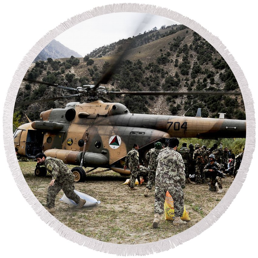 Afghanistan Round Beach Towel featuring the photograph Afghan National Army Soldiers Unload by Stocktrek Images