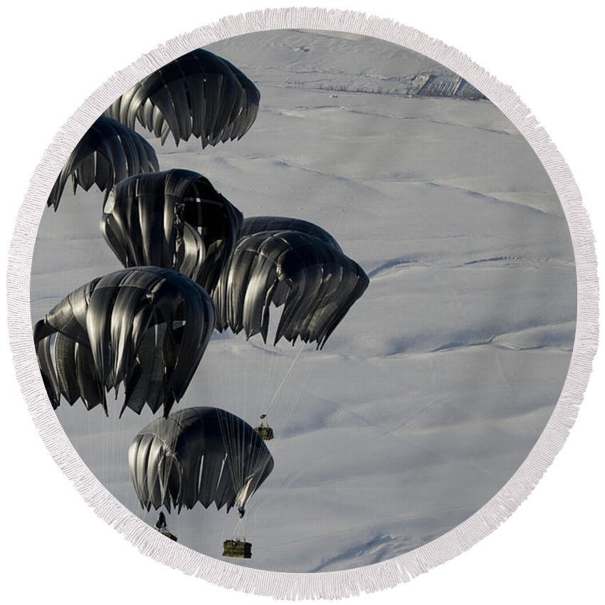 Operation Enduring Freedom Round Beach Towel featuring the photograph Air Delivery Cargo Is Released by Stocktrek Images