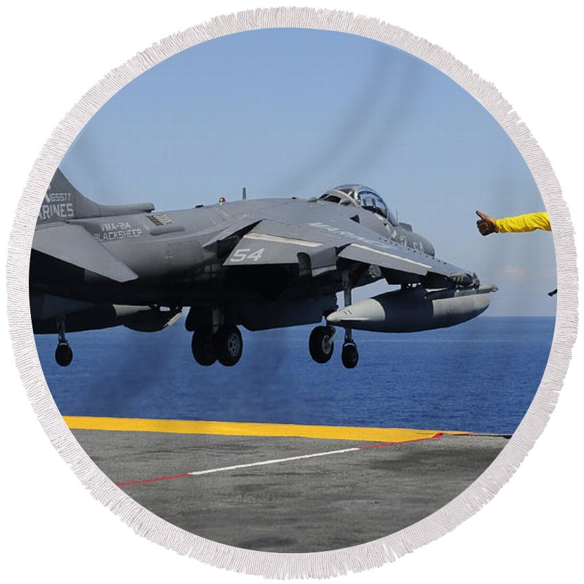 Uss Essex Round Beach Towel featuring the photograph Airman Gives The Thumbs-up Signal As An by Stocktrek Images