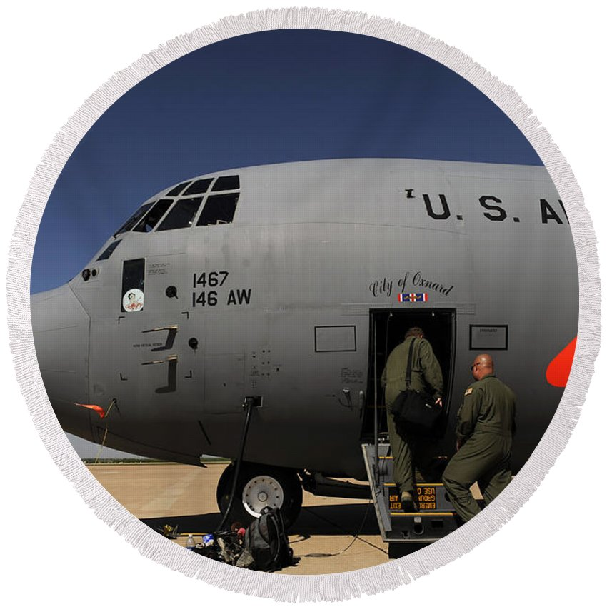 Texas Round Beach Towel featuring the photograph Airmen Board A C-130j Hercules At Dyess by Stocktrek Images