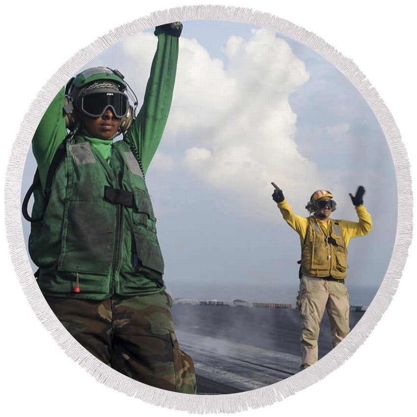 Uss John C Stennis Round Beach Towel featuring the photograph Airmen Communicate To Aircraft Aboard by Stocktrek Images