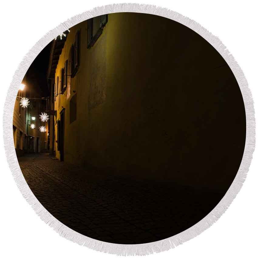 Alley Round Beach Towel featuring the photograph Alley In Night With Lights by Mats Silvan