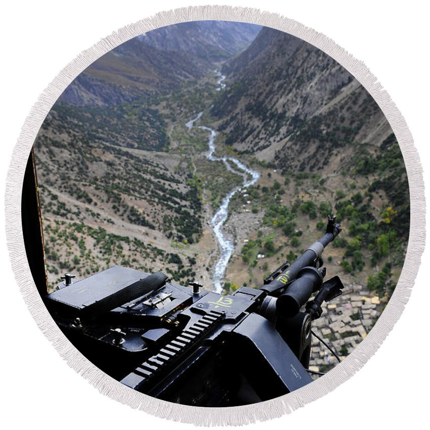 Afghanistan Round Beach Towel featuring the photograph An Aerial Gunner Surveys by Stocktrek Images