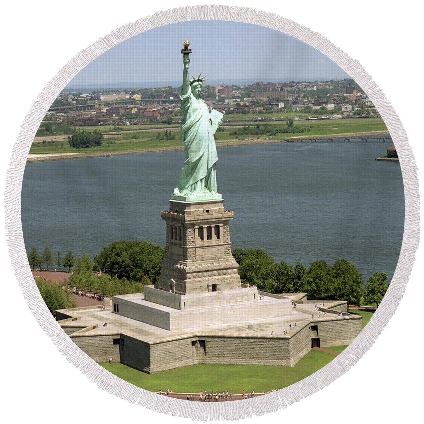 Symbolic Round Beach Towel featuring the photograph An Aerial View Of The Statue Of Liberty by Stocktrek Images