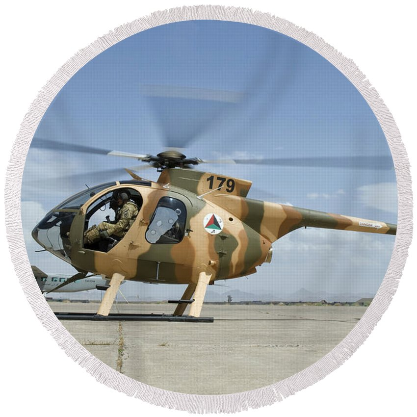 Afghanistan Round Beach Towel featuring the photograph An Afghan Air Force Md-530f Helicopter by Giovanni Colla