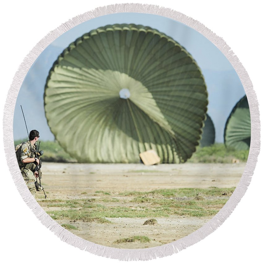 Haiti Round Beach Towel featuring the photograph An Air Delivery Of Humanitarian Aid by Stocktrek Images