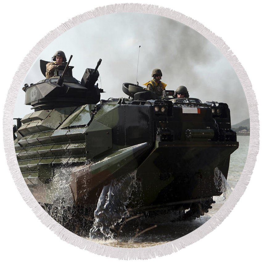 Military Round Beach Towel featuring the photograph An Amphibious Assault Vehicle Hits by Stocktrek Images