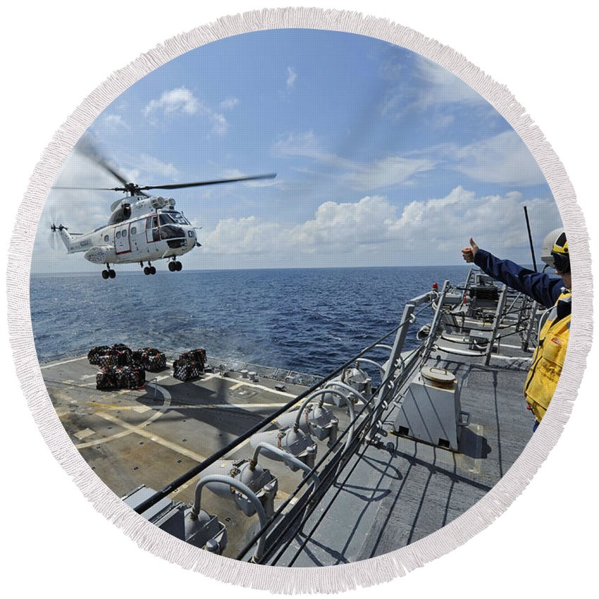 Military Round Beach Towel featuring the photograph An As-332 Super Puma Helicopter by Stocktrek Images
