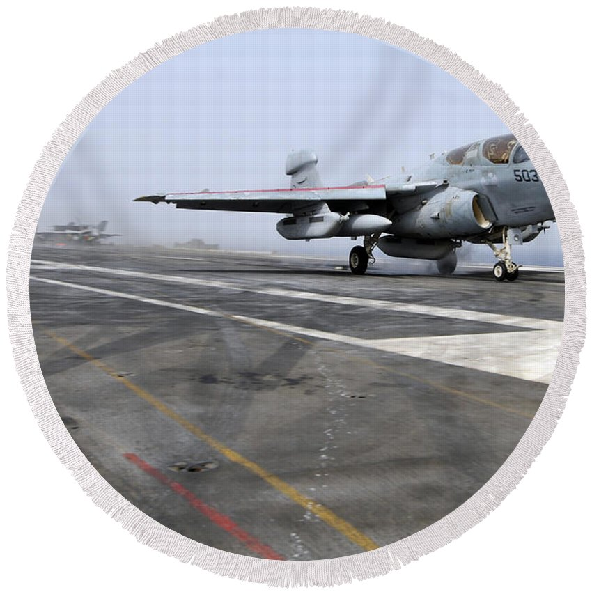 Flight Deck Round Beach Towel featuring the photograph An Ea-6b Prowler Catapults by Stocktrek Images