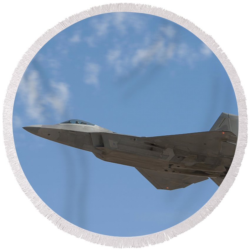 F-22 Round Beach Towel featuring the photograph An F-22 Raptor Takes Flight by Stocktrek Images