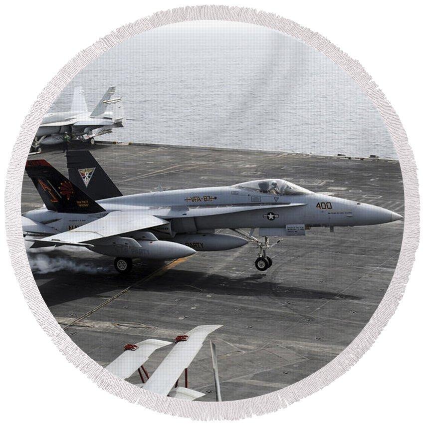 Flight Deck Round Beach Towel featuring the photograph An Fa-18a+ Hornet Lands Aboard by Stocktrek Images