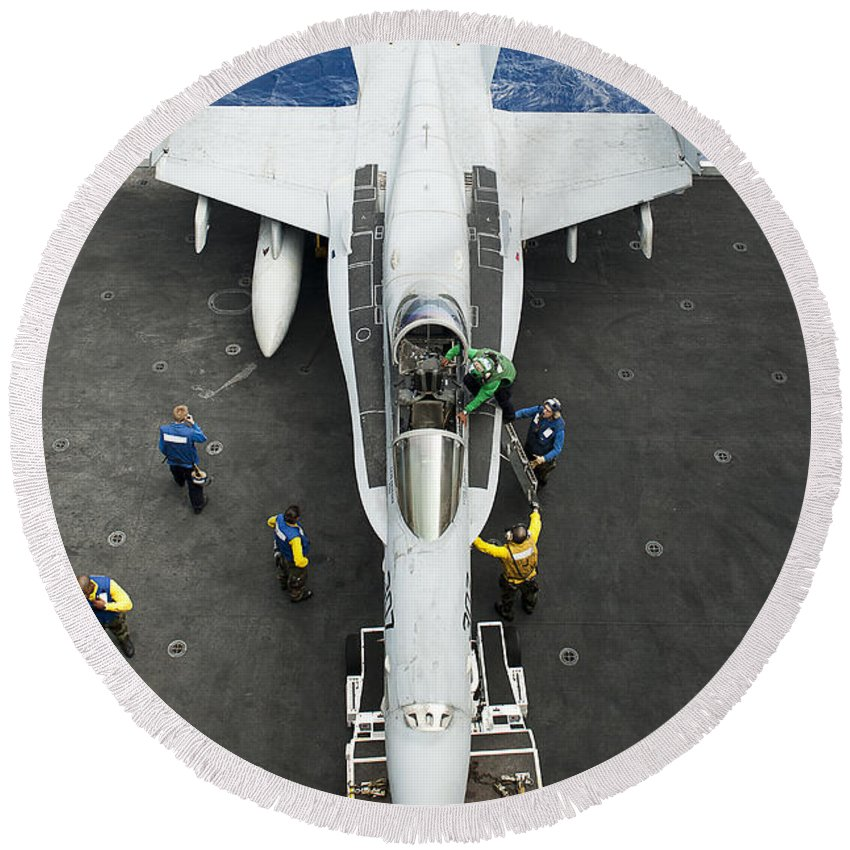 At The Edge Of Round Beach Towel featuring the photograph An Fa-18c Hornet Aircraft by Stocktrek Images