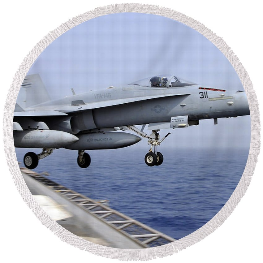 Flight Deck Round Beach Towel featuring the photograph An Fa-18c Hornet Catapults by Stocktrek Images