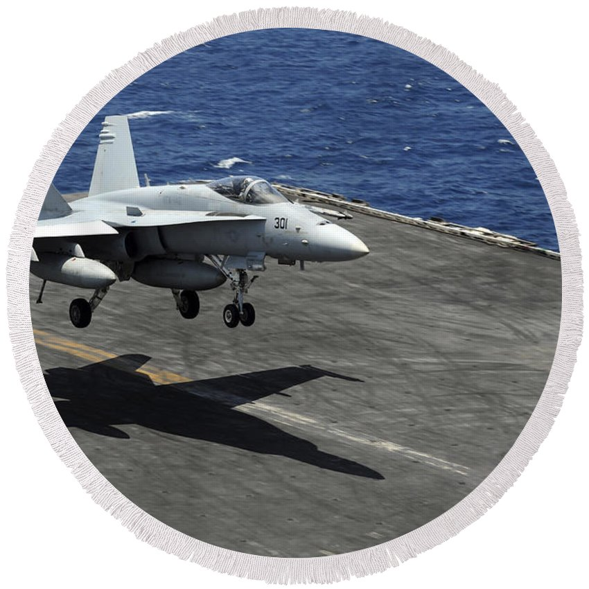 Aircraft Round Beach Towel featuring the photograph An Fa-18c Hornet Lands Aboard by Stocktrek Images