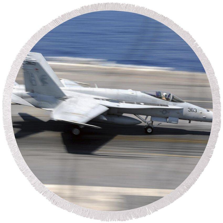 Flight Deck Round Beach Towel featuring the photograph An Fa-18e Super Hornet Lands Aboard Uss by Stocktrek Images