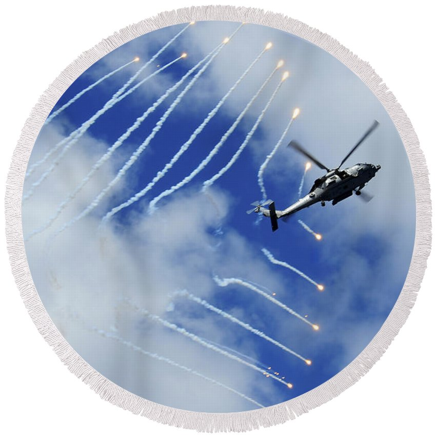 Airshow Round Beach Towel featuring the photograph An Hh-60h Sea Hawk Helicopter Releases by Stocktrek Images