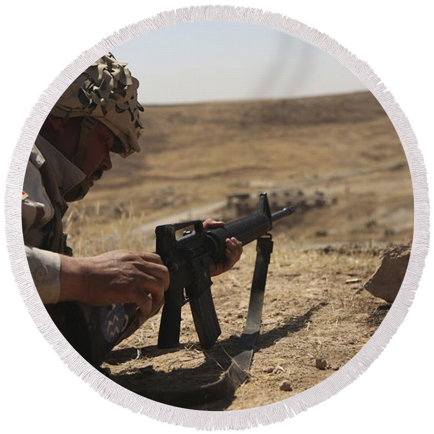 Guzlani Warrior Training Center Round Beach Towel featuring the photograph An Iraqi Army Soldier Prepares To Fire by Stocktrek Images