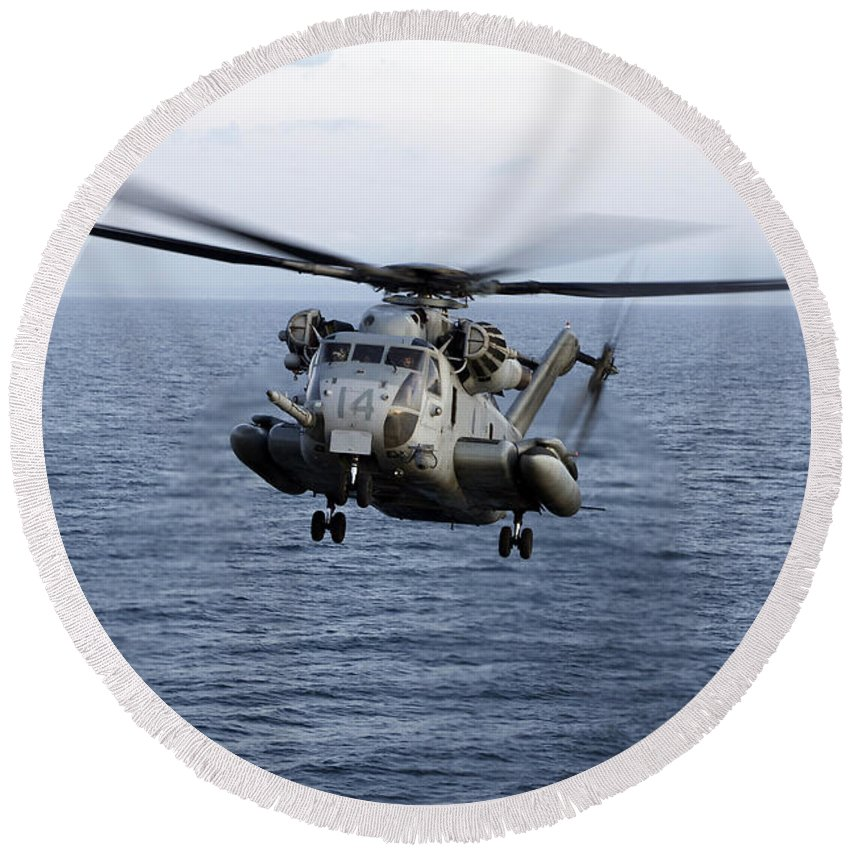 Transportation Round Beach Towel featuring the photograph An Mh-53e Sea Dragon In Flight by Stocktrek Images