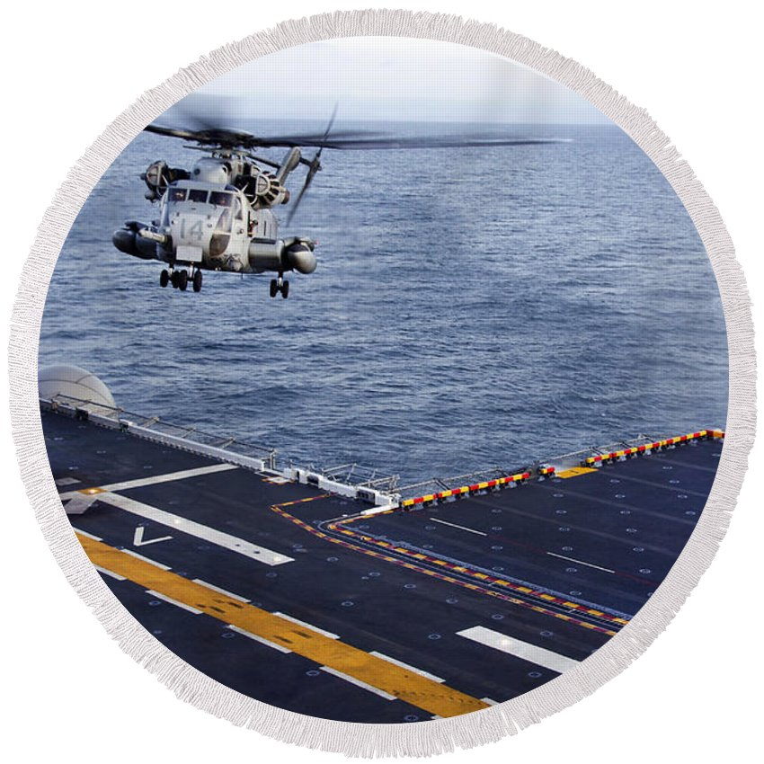 Pacific Ocean Round Beach Towel featuring the photograph An Mh-53e Sea Dragon Prepares To Land by Stocktrek Images