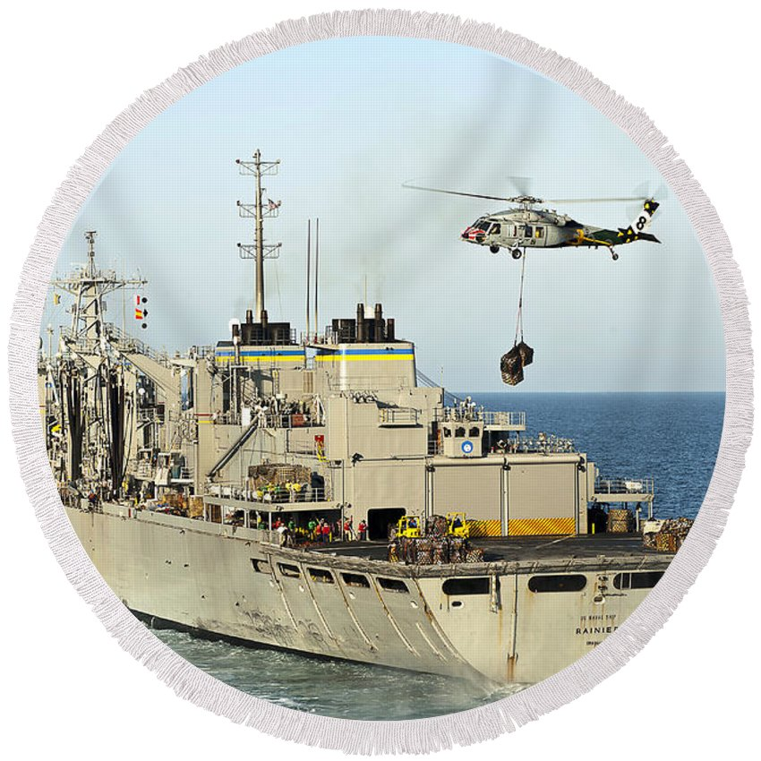 Operation Enduring Freedom Round Beach Towel featuring the photograph An Mh-60s Knighthawk Lifts Cargo by Stocktrek Images