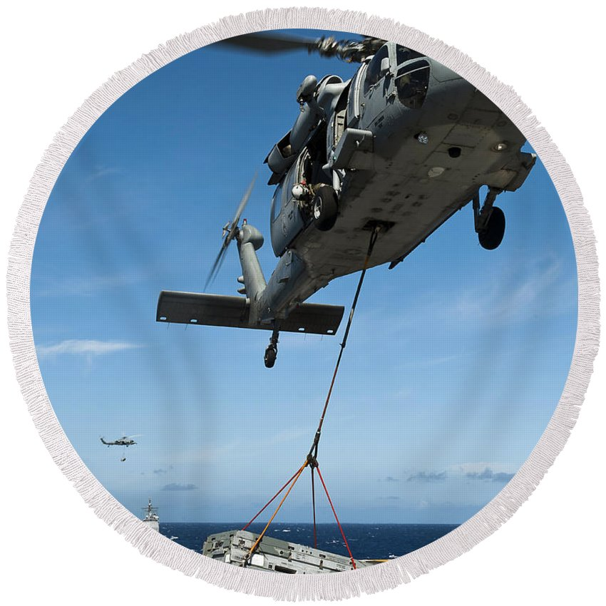 Flight Deck Round Beach Towel featuring the photograph An Mh-60s Sea Hawk Helicopter Lowers by Stocktrek Images