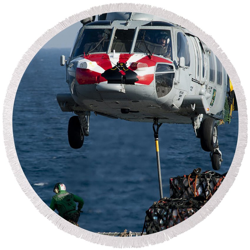 Military Round Beach Towel featuring the photograph An Mh-60s Sea Hawk Picks Up Pallets by Stocktrek Images