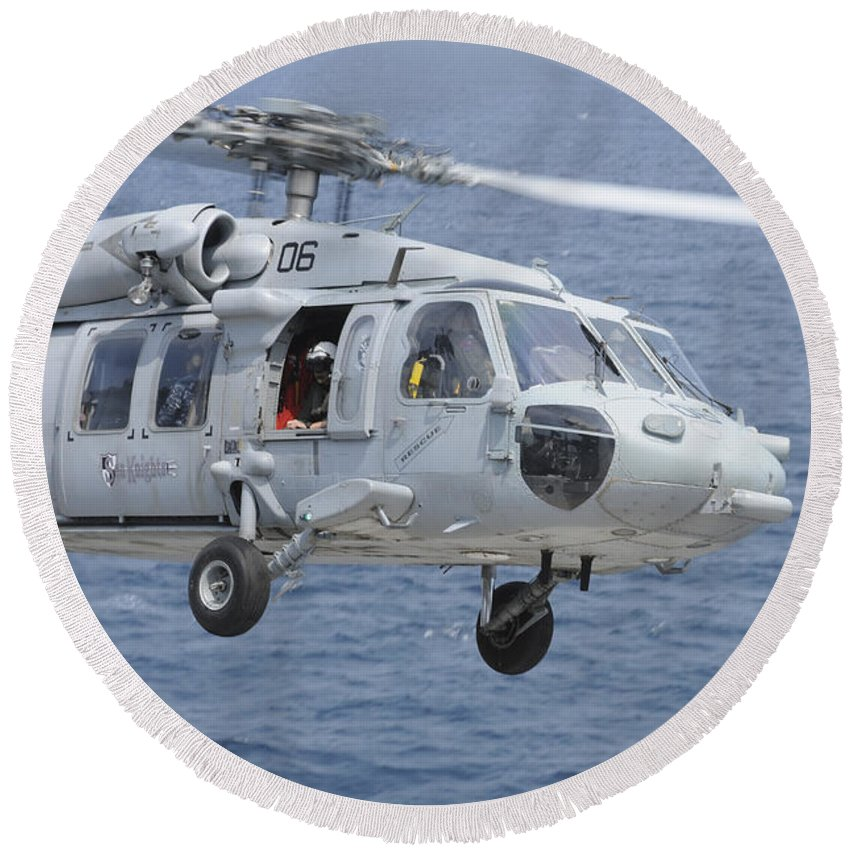 Helicopter Round Beach Towel featuring the photograph An Mh-60s Sea Hawk Search And Rescue by Stocktrek Images