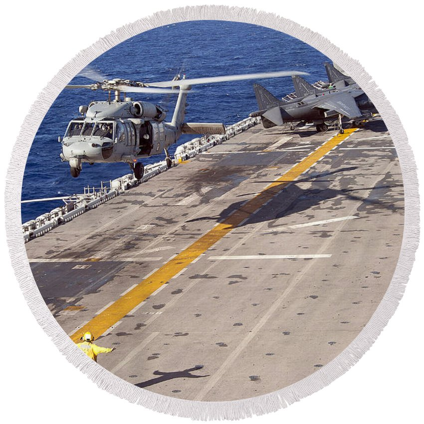 Underway Replenishment Round Beach Towel featuring the photograph An Mh-60s Seahawk Helicopter Prepares by Stocktrek Images