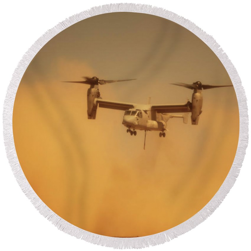 Dust Round Beach Towel featuring the photograph An Mv-22 Osprey Aircraft Blows Dust by Stocktrek Images